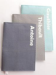 Protège carnet de santé -modèle simple - tissus étoilés et tissu à pois